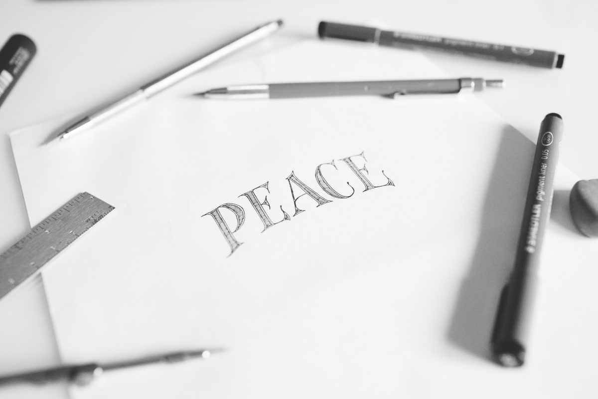 "Picture of the word ""Peace"" hand lettered"